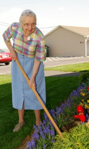 Resident Mary works the soil